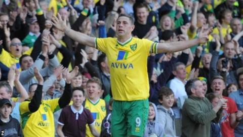 Grant Holt celebrates scoring his first goal