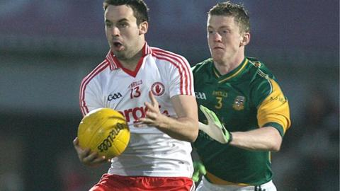 Tyrone's Kyle Coney is challanged by Kevin Reilly