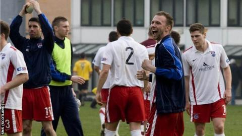 County's players celebrate their narrow win at Firhill