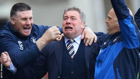 McCoist (centre) celebrates as his side head for victory over their Glasgow rivals