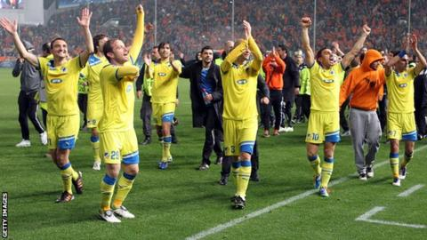 Apoel Nicosia players celebrate after their victory over Lyon in the Champions League