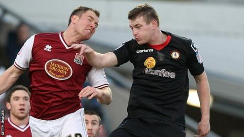 Crewe's Adam Dugdale (right) playing against Northampton