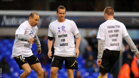 Bolton Wanderers' Kevin Davies (centre) and Martin Petrov (left) wearing T-shirts in support of team-mate Fabrice Muamba before the FA Cup sixth-round tie at White Hart Lane