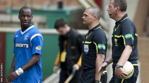 Aluko (left) has words with referee Brines (right) at half-time