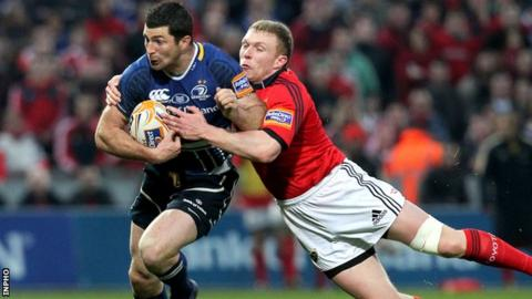 Keith Earls tackles Rob Kearney at Thomond Park