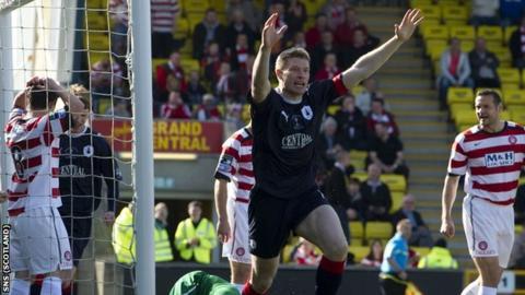 Dods celebrates his winning goal at Livingston's Almondvale Stadium