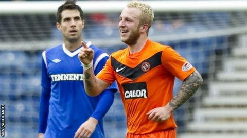 Johnny Russell (right) scored in United's cup victory at Ibrox