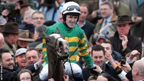 Tony McCoy celebrates his Cheltenham Gold Cup win on Synchronised in March
