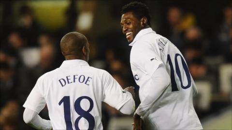 Emmanuel Adebayor celebrates a goal with Tottenham Hotspur team-mate Jermain Defoe