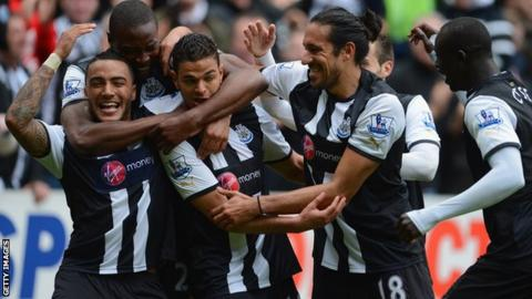Newcastle United players celebrate against Bolton Wanderers