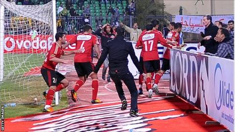 Al Ahly players head from the field during the match against Al Masry