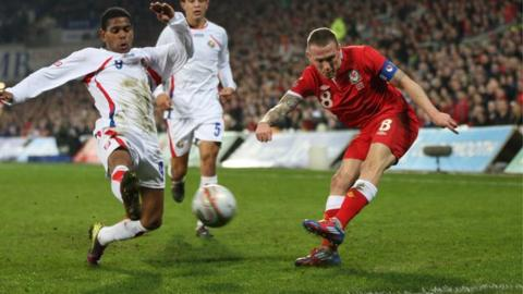 Craig Bellamy fires a shot against Costa Rica