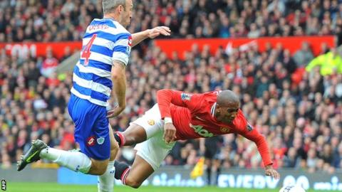 Shaun Derry (left) collides with Manchester United's Ashley Young