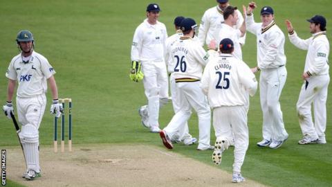 Durham celebrate the wicket of Neil Edwards