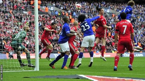 Andy Carroll heads in winner against Everton