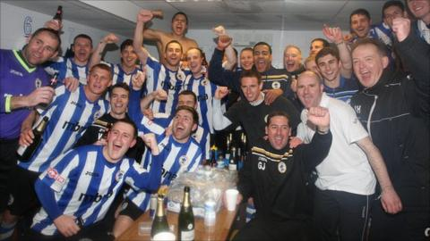 Chester's players celebrate promotion