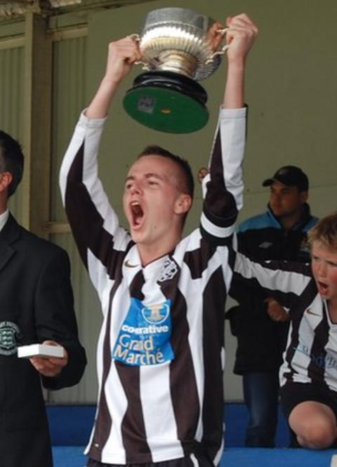 Mark McGrath lifts the Guernsey FA Cup