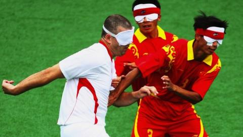 Dave Clarke challenges against China at the 2008 Paralympics