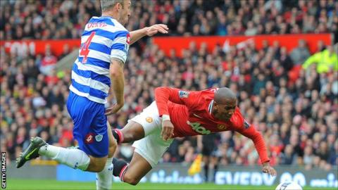 Manchester United's Ashley Young wins a penalty against QPR