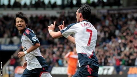 Chris Eagles celebrates scoring Bolton's equaliser against Swansea