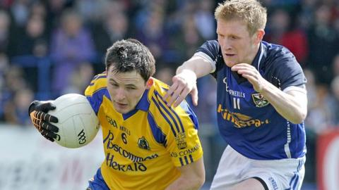 Roscommon's Paddy Broggan is challenged by Chris Conroy