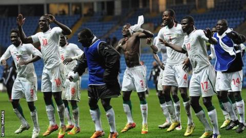 Senegal celebrate beating Oman
