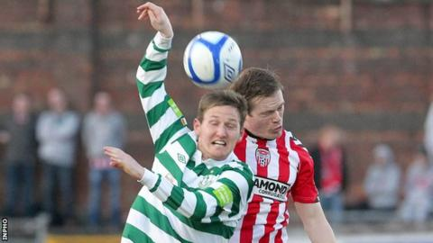 Gary Twigg battles with Derry's Simon Madden at the Brandywell