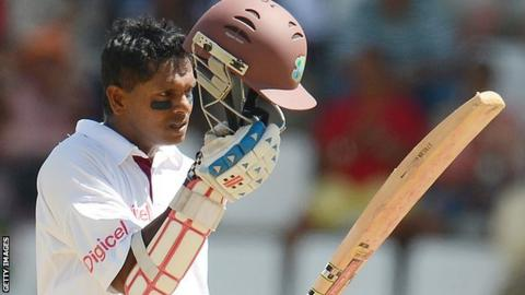 Shivnarine Chanderpaul lifts his helmet after reaching 10,000 Test runs