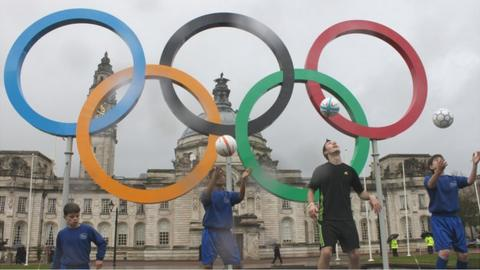 Footballers help unveil the Olympic rings outside Cardiff City Hall