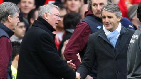 Manchester United manager Sir Alex Ferguson (left) and Manchester City boss Roberto Mancini