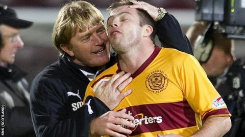 McCall congratulates midfielder Steve Jennings at Tynecastle