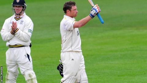 Ian Bell celebrates reaching his hundred