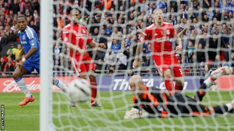 Chelsea striker Didier Drogba scores against Liverpool in the FA Cup final