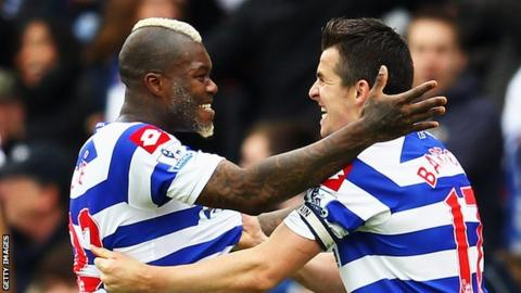 QPR's Djibril Cisse and Joey Barton celebrate their side's win against Stoke