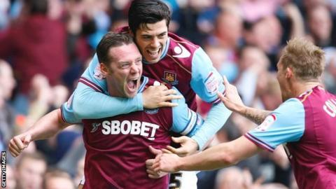 Kevin Nolan (left) celebrates scoring the opening goal with team-mate James Tomkins and Jack Collison (right)