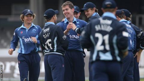 Graeme McCarter celebrates taking his first wicket against Middlesex