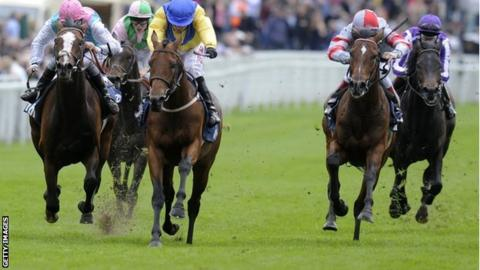 Mickddam (centre, yellow) wins the Chester Vase