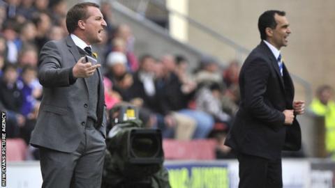 Swansea City manager Brendan Rodgers alongside Wigan Athletic manager Roberto Martinez
