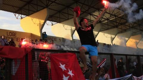 Etoile du Sahel fans celebrate their team's passage to the group phase in Ivory Coast