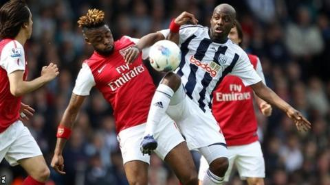 Arsenal and West Brom battle for the ball