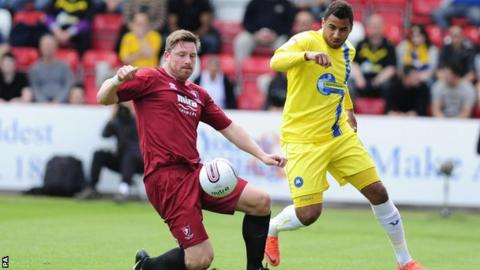 Torquay's Rene Howe (right) is certain to miss the play-off semi-final second leg because of injury