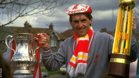 Dalglish with league and cup trophies
