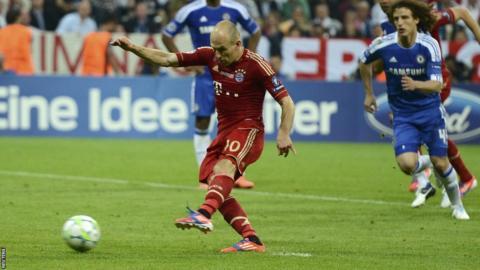 Arjen Robben takes a penalty