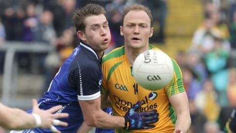 Cavan's David Givney in action against Colm McFadden of Donegal