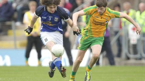 Cavan's Conor Smyth is challenged by Dara Mulgrew in the minor game