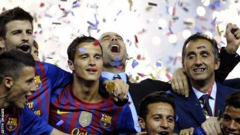 Pep Guardiola celebrates after his final game in charge of Barcelona.