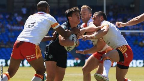 Catalan try to stop Michael Channing