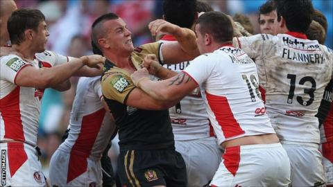 Wigan and St Helens players were involved in a mass brawl during their Magic Weekend encounter
