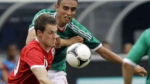 Aaron Ramsey holds off Mexico's Jesus Zavala during the 2-0 defeat in New Jersey