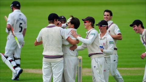 Somerset celebrate the wicket of Paul Collingwood